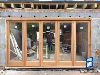 Wooden bi-fold door installations