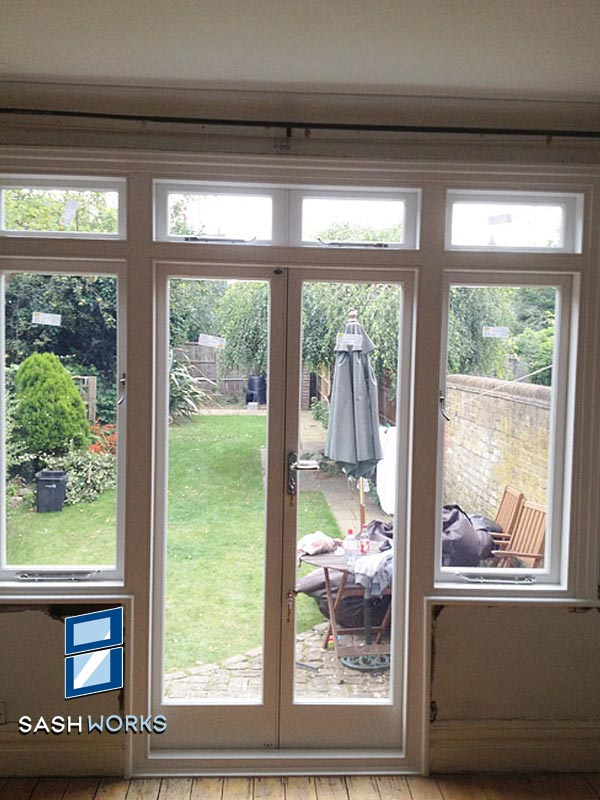 Part glazed wooden patio door installation