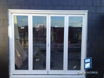Wooden bi-fold door installation